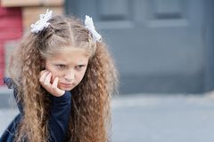 Portrait of a beautiful young Schoolgirl. Farewell Bell. day of knowledge. beginning of the school year stock image