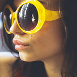 Portrait of a beautiful young brunette girl with expressive eyes and full lips, and sunglasses posing for the camera. Close-up portrait of a beautiful young royalty free stock photos