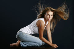 Portrait of a beautiful young woman. With flowing hair royalty free stock photography