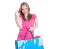 Portrait of beautiful young shopaholic with luck sign Stock Photography