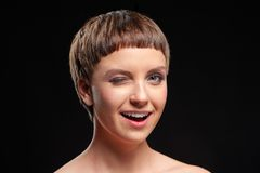 Portrait of beautiful young short hair woman winking to you Stock Photo