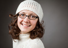 Portrait of a beautiful young smiling brunette wearing chochet h Royalty Free Stock Photo