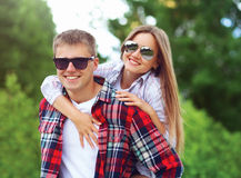 Portrait of beautiful young smiling couple in sunglasses Royalty Free Stock Images