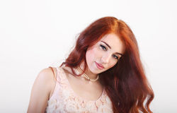 Portrait beautiful young smiling girl with red long hair Stock Image