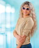 Portrait of beautiful young smiling standing woman on background Royalty Free Stock Photo