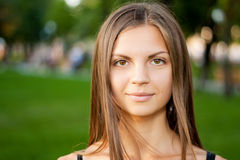 Portrait of a beautiful young smiling woman Royalty Free Stock Photos