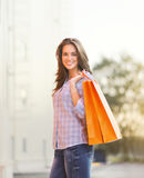 Portrait of beautiful young smiling woman with shopping bag Royalty Free Stock Images
