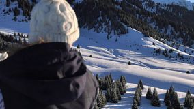 Portrait of beautiful young snowboarder woman looking at aerial view. stock video