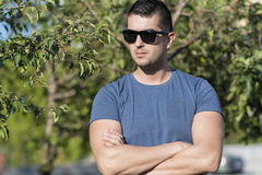 Portrait of beautiful young strong man  on the street Royalty Free Stock Photo