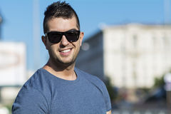 Portrait of beautiful young strong man  on the street Royalty Free Stock Photos