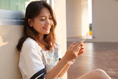 Portrait of beautiful young and teen woman looking to mobile pho Royalty Free Stock Photos