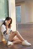 Portrait of beautiful young and teen woman talking mobile phone Stock Image