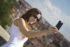 Portrait of a beautiful young tourist woman Stock Photos