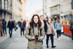 Portrait Beautiful young tourist woman stands in the background of a crowd of people on a central street in Munich in Germany in w stock images