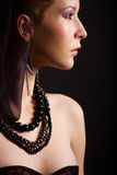 Portrait beautiful young woman. In profile on the black backgraund Stock Photos
