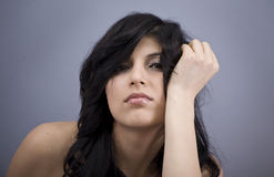 Portrait of a beautiful young woman. Portrait of a young beautiful woman sitting, studio shot stock photos