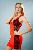 Portrait of a beautiful young woman. In red dress Royalty Free Stock Photo