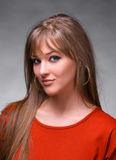 Portrait of beautiful young woman. Looking at camera on a gray backround royalty free stock photo