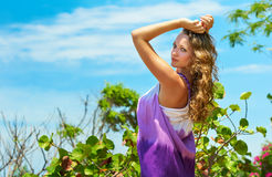 Portrait beautiful young woman against a blue sky. royalty free stock photos
