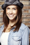 Portrait of a beautiful young woman, against brick wall Royalty Free Stock Photography
