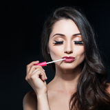 Portrait of a beautiful young woman applied lip gloss Royalty Free Stock Image