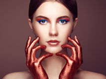 Portrait of beautiful young woman with art make-up Royalty Free Stock Image