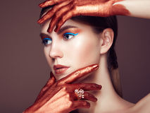 Portrait of beautiful young woman with art make-up Stock Image
