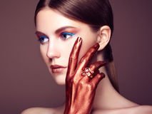 Portrait of beautiful young woman with art make-up Royalty Free Stock Photo