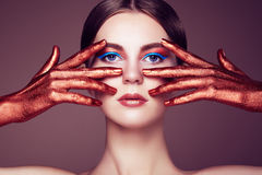 Portrait of beautiful young woman with art make-up Royalty Free Stock Images