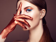 Portrait of beautiful young woman with art make-up Stock Photos