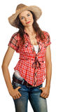 Portrait of a beautiful young  woman with attitude. An isolated portrait of a beautiful young cowgirl with attitude Royalty Free Stock Photo