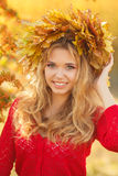 Portrait of beautiful young woman in autumn park. royalty free stock photography