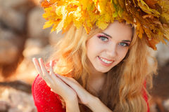 Portrait of beautiful young woman in autumn park. Stock Images