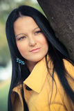Portrait of beautiful young woman in autumn park Stock Photo