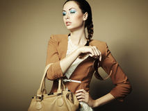 Portrait of beautiful young woman with bag Royalty Free Stock Images