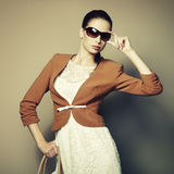 Portrait of beautiful young woman with bag Royalty Free Stock Photography