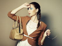 Portrait of beautiful young woman with bag Stock Photos