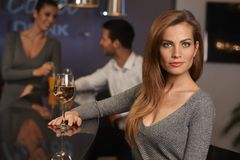 Portrait of beautiful young woman in bar Royalty Free Stock Image