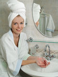 Portrait of a beautiful young woman in a bathroom royalty free stock photography