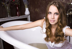Portrait of beautiful young woman in bathroom Royalty Free Stock Image