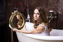 Portrait of beautiful young woman in bathroom Royalty Free Stock Photography