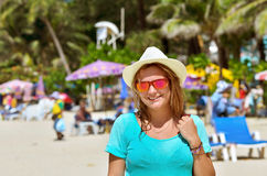 Portrait of beautiful young woman at the beach. Girl in a hat Royalty Free Stock Photos