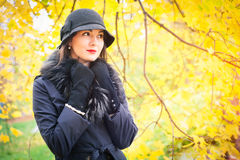 Portrait of a beautiful young woman in black coat Royalty Free Stock Photos