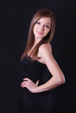 Portrait of a beautiful young woman in black dress Stock Photo