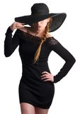 Portrait of a an beautiful young woman in black hat Royalty Free Stock Image