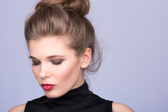 Portrait of beautiful young woman in a black turtleneck. Look down Royalty Free Stock Images
