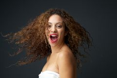 Portrait of a beautiful young woman with blowing hair laughing Stock Image