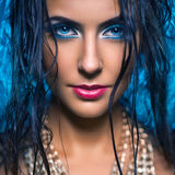 Portrait of beautiful young woman with blue eye closed Royalty Free Stock Photography