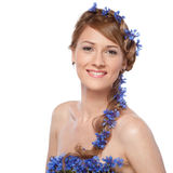 Portrait of beautiful young woman with blue flowers Stock Images