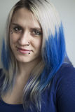 Beautiful Young Woman with Blue Hair Royalty Free Stock Images